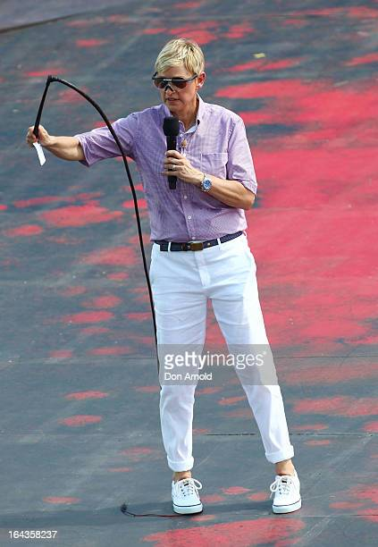 Television personality Ellen DeGeneres attempts to crack a whip on the set of her television show being filmed on a stage above Sydney Harbour on...