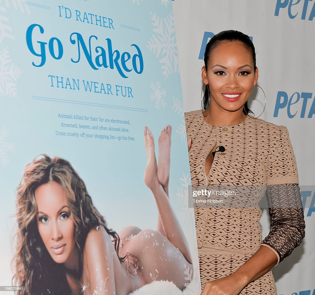 Television personality Evelyn Lozada unveils her naked anti-fur ad for PETA at The Bob Barker Building on December 11, 2012 in Los Angeles, California.