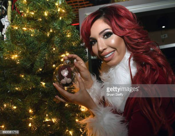 Television personality Farrah Abraham is presented a Christmas tree ornament with her likeness during the Crazy Horse III Gentlemen's Club's NEON...