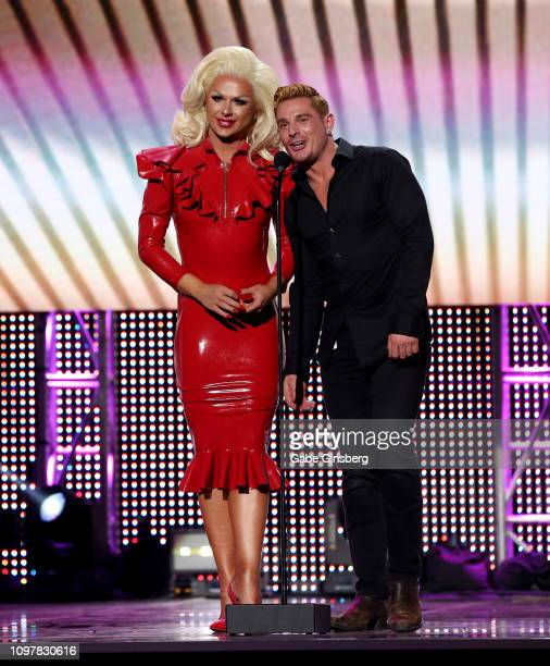Television personality Farrah Moan and adult film actor Brent Corrigan present an award during the 2019 GayVN Awards show at The Joint inside the...