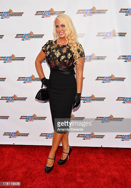 Television personality Genevieve Chappell arrives at the premiere of Snake Mongoo$e at the Egyptian Theatre on August 26 2013 in Hollywood California