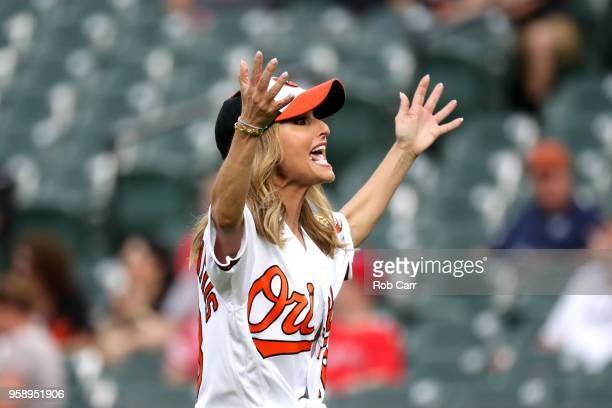 Television personality Giada De Laurentiis reacts after throwing out the ceremonial first pitch before the start of the rain delayed Baltimore...