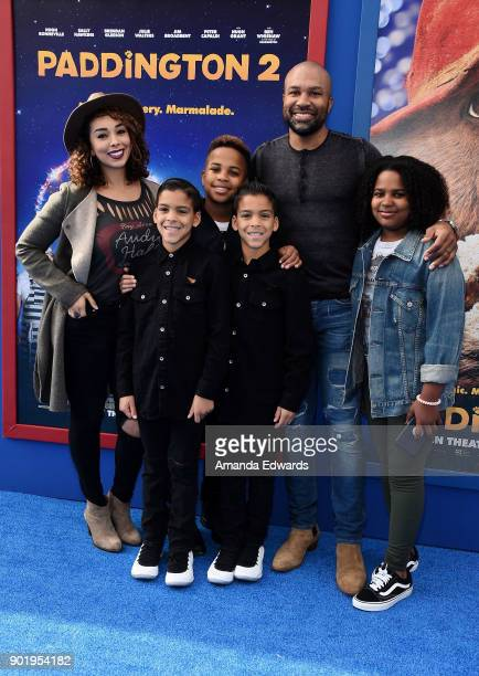 Television personality Gloria Govan former NBA player Derek Fisher and kids arrive at the premiere of Warner Bros Pictures' 'Paddington 2' at the...