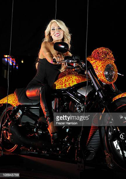 Television personality Gretchen Rossi arrives at the Harley Davidson showcase unveiling of 'Cosmic Harley' designed by artist Jack Armstrong at the...