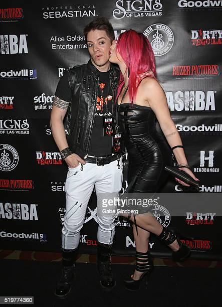 Television personality JD Scott and model Annalee Belle attend the grand opening of guitarist Dj Ashba's Ashba Clothing Store at the Stratosphere...