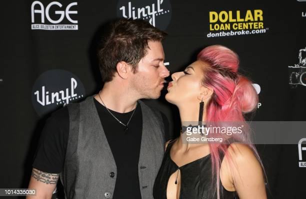 Television personality JD Scott kisses model Annalee Belle during a CD release party for COOP at Vinyl inside the Hard Rock Hotel Casino on August 9...