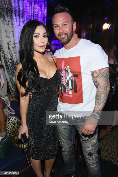 Television personality Jenni 'JWoww' Farley and Roger Mathews attend MTV's 'Jersey Shore Family Vacation' New York premiere party at PHD at the Dream...