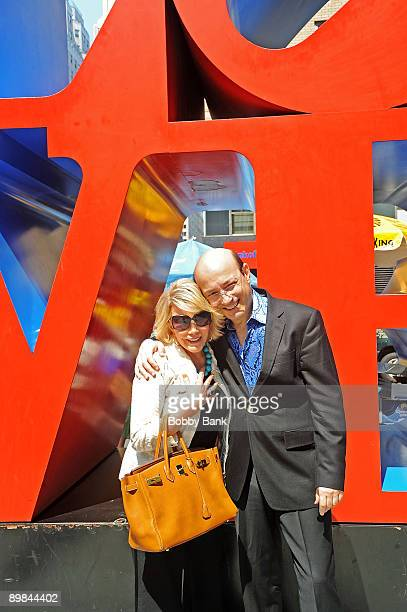 Television personality Joan Rivers poses with Norm Zada of Perfect 10 Magazine at the LOVE statue on the streets of Manhattan on August 17 2009 in...