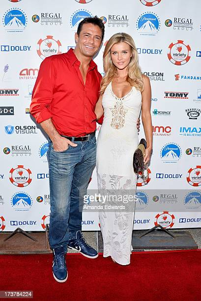 Television personality Joanna Krupa and her husband Romain Zago arrive at The Children's Charity Of Southern California Texas Hold 'Em Poker...