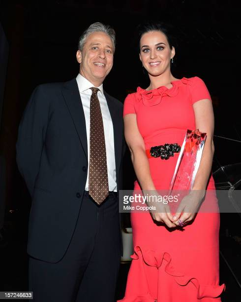 Television personality Jon Stewart and singer Katy Perry pose with her Billboard Woman of The Year award at the 2012 Billboard Women In Music...