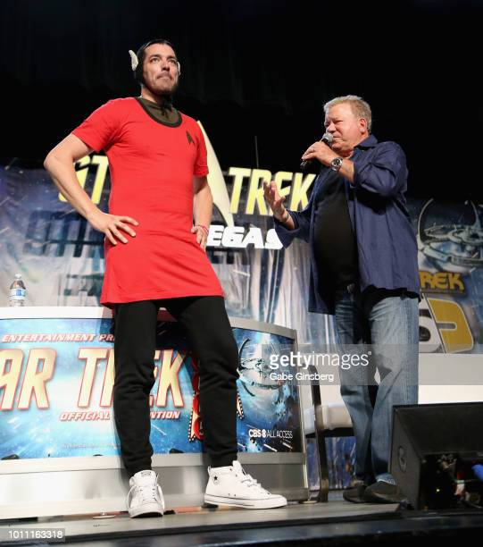 Television personality Jonathan Scott walks onstage in a Star Trek themed costume as actor William Shatner speaks at the William Shatner panel during...