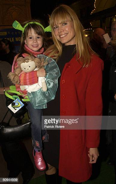 Television personality Karen Fisher and her daughter attend the Shrek2 Premiere at the State Theatre June 9 2004 in Sydney Australia