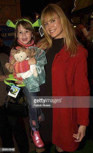 Television personality Karen Fisher with her daughter attend the Shrek2 Premiere at the State Theatre June 9 2004 in Sydney Australia