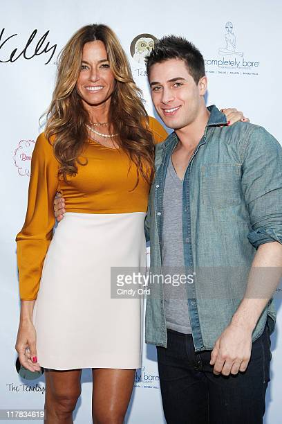 Television personality Kelly Bensimon and L'Noir designer Andrew Kanakis attend the 2011 Summer Jewelry Soiree at the Completely Bare Salon on June...