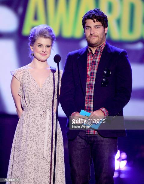 Television personality Kelly Osbourne and actor Adam Pally speak onstage during the 2012 Do Something Awards at Barker Hangar on August 19, 2012 in...