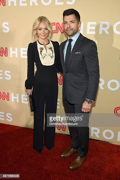 Television personality Kelly Ripa and Kelly Ripa Mark Consuelos attend CNN Heroes 2015 Red Carpet Arrivals at American Museum of Natural History on...