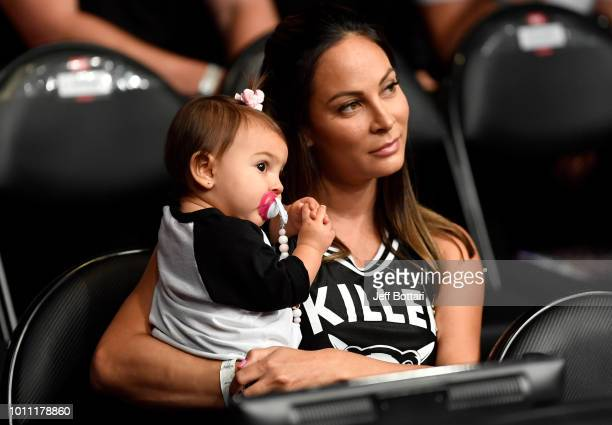 Television personality Kenda Perez and daughter Royal look on as her husband Cub Swanson fights during the UFC 227 event inside Staples Center on...