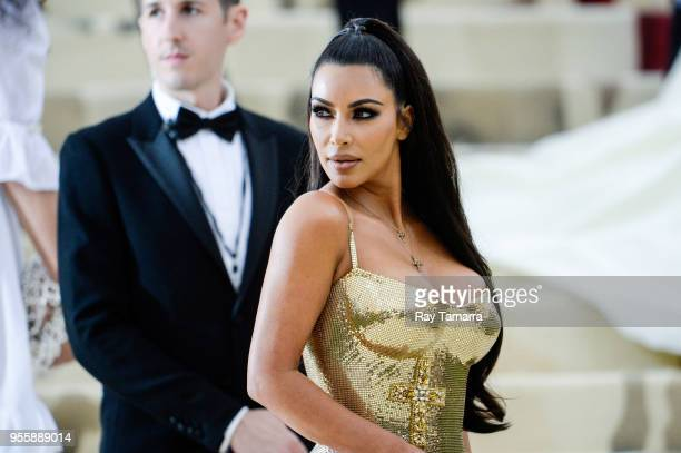 Television personality Kim Kardashian enters the Heavenly Bodies Fashion The Catholic Imagination Costume Institute Gala at The Metropolitan Museum...