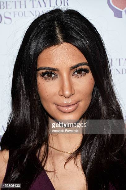Television personality Kim Kardashian poses after raising a toast for the Elizabeth Taylor Foundation/World AIDS Day at The Abbey on December 1 2014...