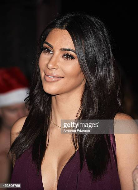 Television personality Kim Kardashian raises a toast for the Elizabeth Taylor Foundation/World AIDS Day at The Abbey on December 1 2014 in West...