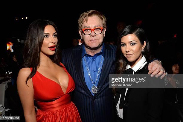 Television personality Kim Kardashian recording artist Sir Elton John and television personality Kourtney Kardashian attends the 22nd Annual Elton...