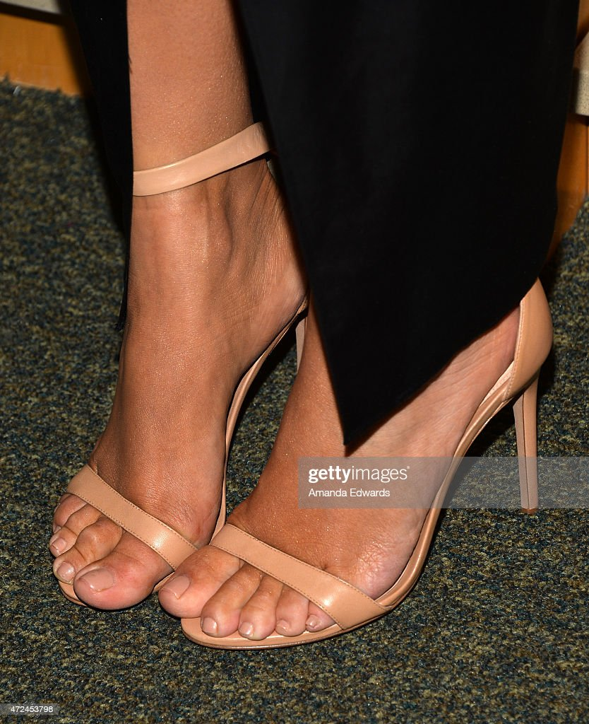 Television personality Kim Kardashian, shoe detail, poses before