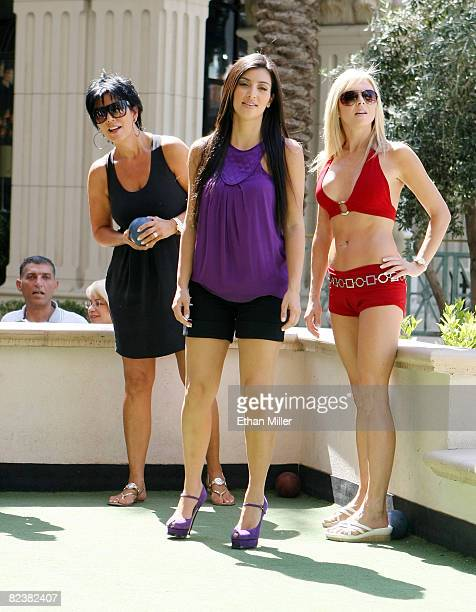 Television personality Kris Jenner her daughter Kim Kardashian and bocce ball instructor Emma Hughes play bocce ball at Rao's at Caesars Palace...
