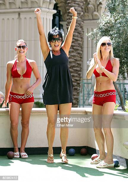 Television personality Kris Jenner reacts while playing bocce ball as bocce ball instructors Jackie Savitt and Emma Hughes look on at Rao's at...