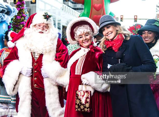 Television personality Lara Spencer poses with Santa Claus and Mrs Claus during the 98th Annual 6abc/Dunkin' Donuts Thanksgiving Day Parade on...