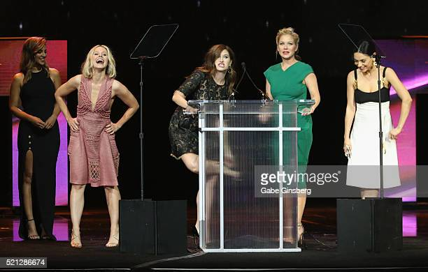 Television personality Liz Hernandez watches as actresses Kristen Bell Kathryn Hahn Christina Applegate and Mila Kunis accept the Female Stars of the...