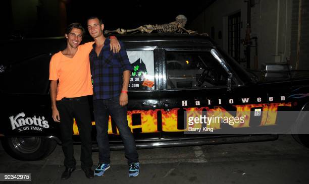 Television personality Madison Hildebrand and Frank Meli attends Knotts Scary Farm Haunt on October 25 2009 in Buena Park California