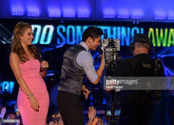 Television personality Maria Menounos and actor Harry Shum, Jr. Speak onstage during the 2012 Do Something Awards at Barker Hangar on August 19, 2012...