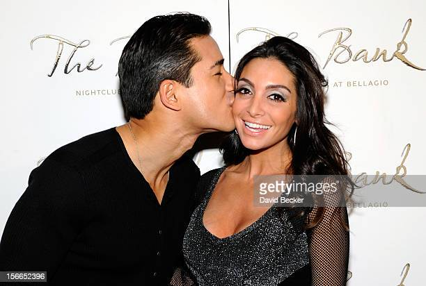 Television personality Mario Lopez and his fiancee Courtney Mazza arrive at Mazza's bachelorette party at The Bank Nightclub at the Bellagio on...