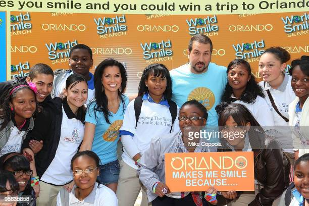 Television personality Melissa Rycroft and singer/actor Joey Fatone pose for pictures with kids at Smile Train's World Smile Search in Madison Square...