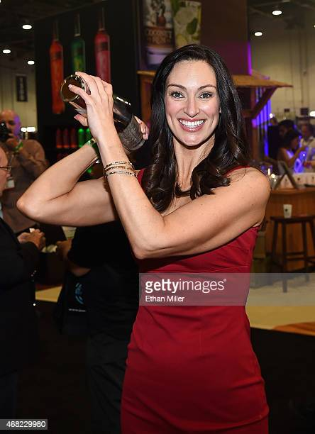 Television personality Mia Mastroianni makes a drink during 30th annual Nightclub Bar Convention and Trade Show at the Las Vegas Convention Center on...