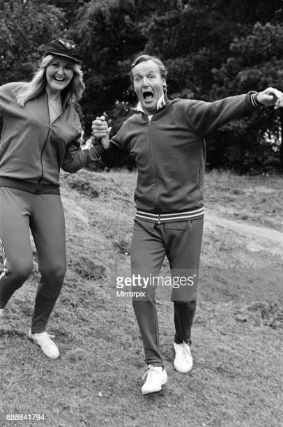 Television personality Nicholas Parsons jogging with his daughter September 1976