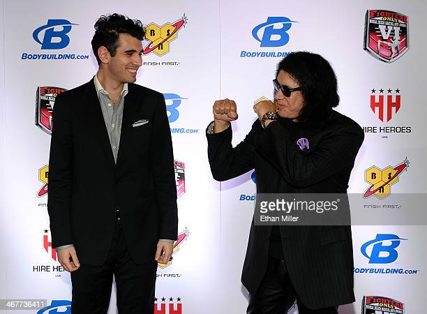 Television personality Nick Simmons and his father Kiss singer/bassist Gene Simmons joke around as they arrive at the sixth annual Fighters Only...