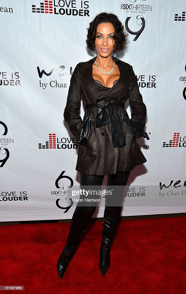 Television Personality Nicole Murphy arrives at Chaz Dean's Holiday Party Benefitting the Love is Louder Movement on December 1, 2012 in Los Angeles, California.