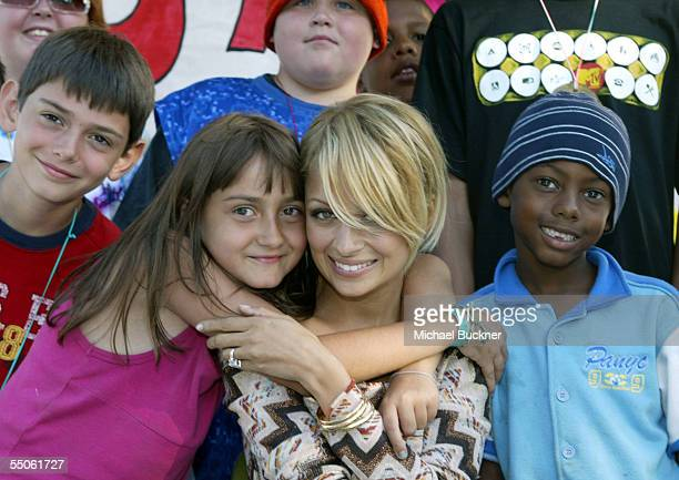 Television personality Nicole Richie poses with campers at Camp Heartland a summer camp that serves children infected with or affected by HIV/AIDS on...