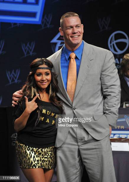 Television personality Nicole Snooki Polizzi and pro wrestler John Cena attend the WrestleMania XXVII press conference at Hard Rock Cafe New York on...