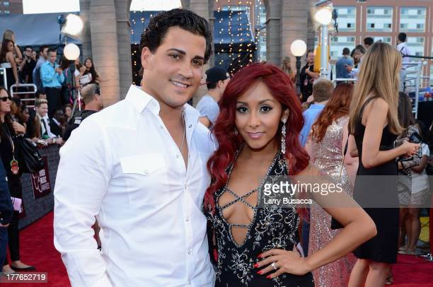 Television personality Nicole 'Snooki' Polizzi with husband Jionni LaValle attend the 2013 MTV Video Music Awards at the Barclays Center on August 25...