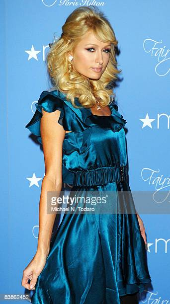 Television personality Paris Hilton launches her new fragrance Fairy Dust at Macy's at the Woodbridge Center Mall on November 30, 2008 in Woodbridge,...