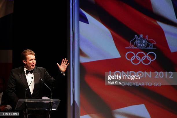 Television personality Peter Overton and event MC speaks during the Australian Olympic Committee Black Tie Dinner at the Sydney Convention Exhibition...