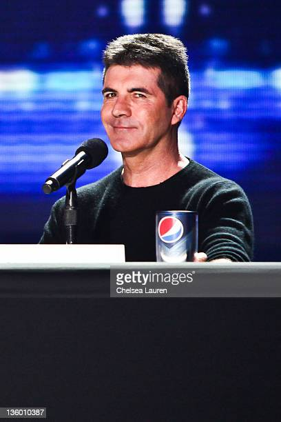 Television personality / producer Simon Cowell attends The X Factor press conference at CBS Television City on December 19 2011 in Los Angeles...