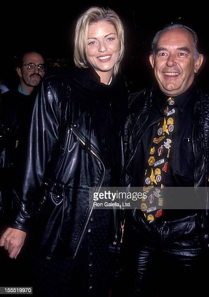 Television Personality Robin Leach and Cecilia Nord attend the grand opening of The Harley Davidson Cafe on October 19 1993 in New York City