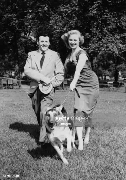 Television personality Sabrina the girl who made a million fans without uttering a sound tries to control her Alsatian as she walks with singer Jimmy...