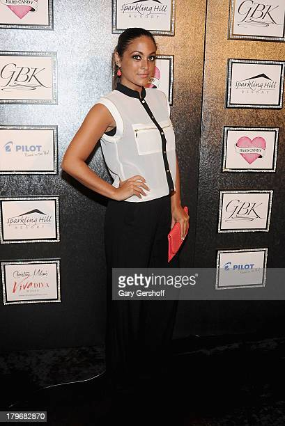 Television personality Sammi Giancola poses at the GBK Sparkling Resort Fashionable Lounge during MercedesBenz Fashion Week on September 6 2013 in...