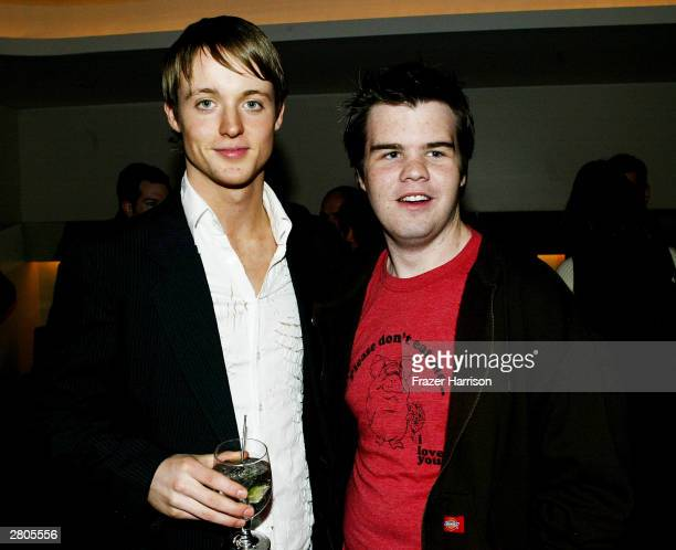 Television personality Simon of The Real World and actor Ash Christian of Six Feet Under mingle at the after party for City of Hope's oneofakind...