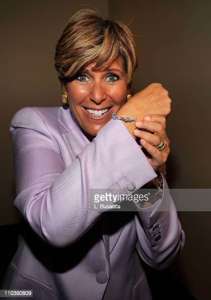 Television personality Suze Orman shows the Avon Women's Empowerment bracelet during the luncheon at the second annual Global Summit for a Better...