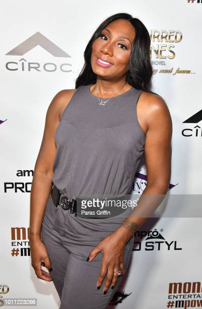"Television personality Towanda Braxrton attends the Mona Scott-Young ""Blurred Lines"" book signing and reception at Billboard Studios on August 4,..."